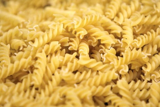 Rejected pieces of fusilli pasta pass along the production line inside Barilla Holding SpA's pasta factory in Parma, Italy, on Wednesday, Oct. 3, 2012. Barilla Holding SpA is the world's biggest pasta manufacturer. Photographer: Alessia Pierdomenico/Bloomberg via Getty Images