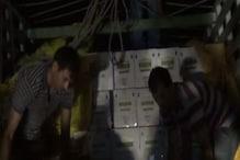 पशु चारे में छिपाकर ले जा रहे थे 30 लाख की अवैध शराब, दो गिरफ्तार