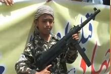 VIDEO- आतंकी हाफिज सईद के रोडशो में AK-47 के साथ बच्चे