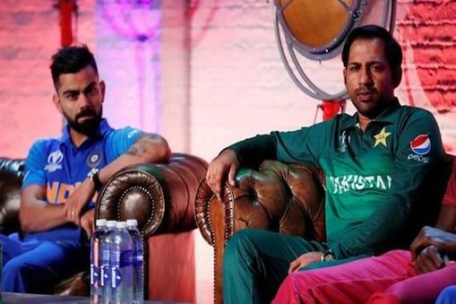 भारत के कप्तान विराट कोहली और पाकिस्तान के कप्तान सरफराज अहमद.