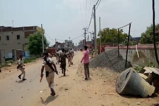 नालंदा में उपद्रव के बाद लोगों को खदेड़ती पुलिस