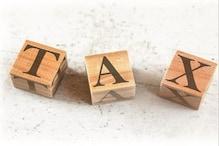 कॉरपोरेट टैक्स में कमी से इन दो सेक्टर्स को होगा फायदा- रिपोर्ट
