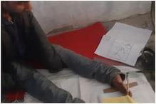 UP Board: पैरों के सहारे 12वीं की परीक्षा दे रहा है छात्र, DM ने कही ये बात