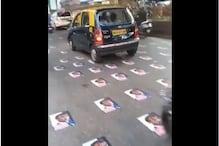 मुंबई में लोगों ने सड़क पर चिपकाए मैक्रों के पोस्टर, पात्रा ने उद्धव को घेरा