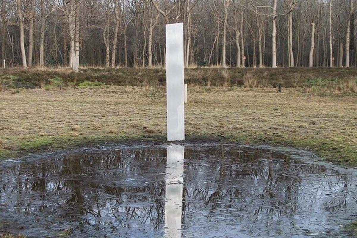 World, USA, Romania, Britain, Europe, Monolith Shiny metallic pillar,
