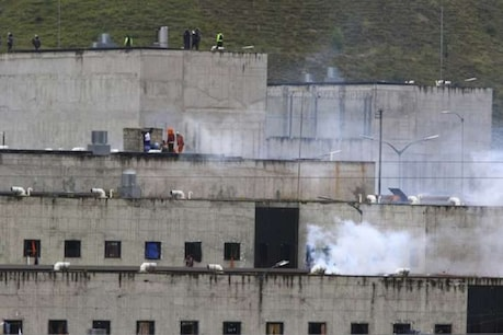 During the skirmish between prisoners in Ecuador's jails, the police released tear gas shells.  (AP)
