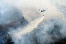 जंगलों में आग लगने पर कैसे काम आते हैं हेलिकॉप्टर, कैसे बरसाते हैं पानी?