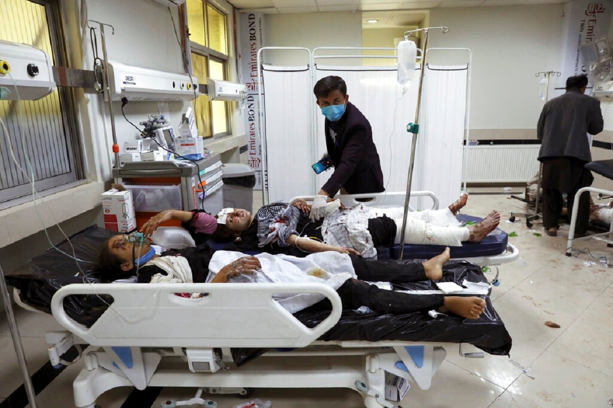 Afghan school students are treated at a hospital after a bomb explosion near a school in west of Kabul, Afghanistan, Saturday, May 8, 2021. A bomb exploded near a school in west Kabul on Saturday, killing several, many them young students, Afghan government spokesmen said. (AP Photo/Rahmat)