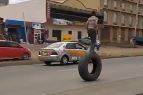 A young man performing a stunt on a truck's tire.  (PC Twitter)