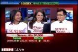 Sensex breaches 30,000 mark, Nifty above 9,100 on RBI rate cut