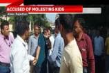 Mob Thrashes Suspended Teacher