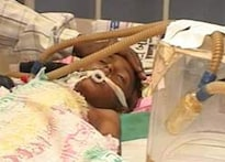 Lives torn apart: Injured mother and son in coma