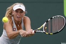 Wozniacki retires, Li Na advances in Warsaw Open