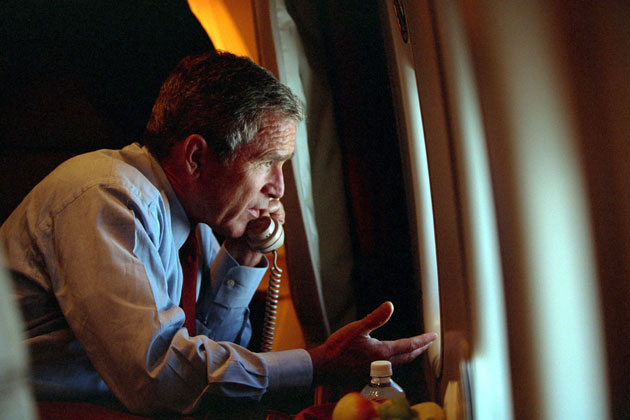 US President George W Bush speaks to Vice President Dick Cheney by phone aboard Air Force One September 11, 2001 after departing Offutt Air Force Base in Nebraska.