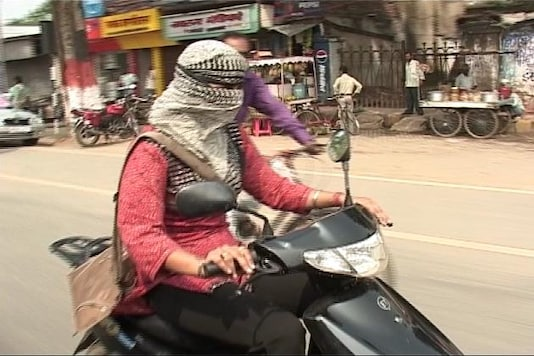 Make helmets compulsory for women: Delhi HC