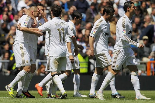 Madrid ease past Sevilla to edge closer to title