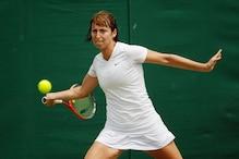 Yvonne Meusburger beats Andrea Hlavackova for first career title
