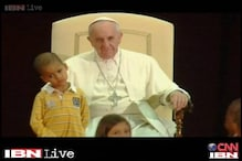 Little boy sits in Pope's chair, steals the show