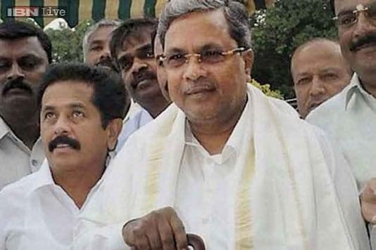 Siddaramaiah inducts 'tainted' D K Shivakumar, R Roshan Baig into Cabinet