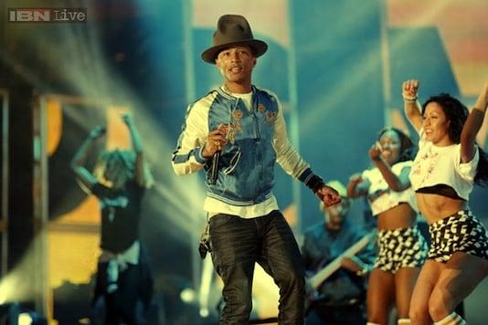 'Happy' singer Pharrell Williams chucks expensive bling for holistic jewellery