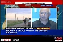 Plane did not make a distress call, says Malaysian PM; probe ordered