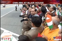 Excited NRIs stand outside Blair House to catch PM Modi's glimpse