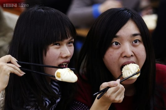 A Beijing restaurant offers free food to beautiful women