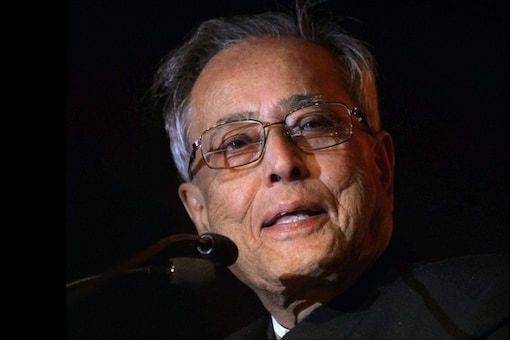 President Pranab Mukherjee greets workers on Labour Day