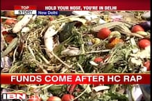 Sanitation workers in East Delhi relent but politics over garbage continues