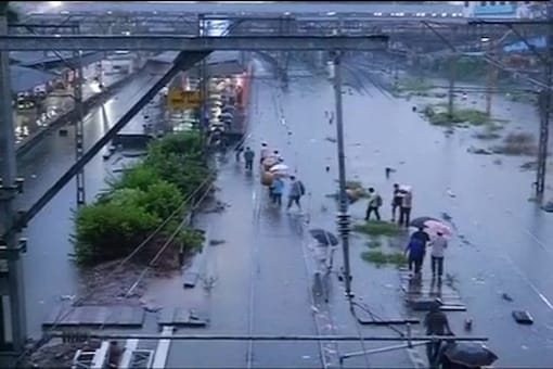 Mumbai limps back to normalcy after heavy rains, train services restored; water logging cleared