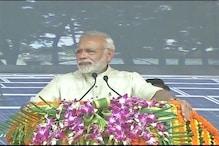 Terming Bapu his 'inspiration', Modi bats for saving environment