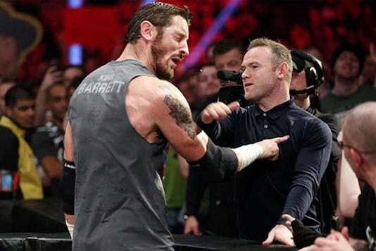 Manchester United and England striker Wayne Rooney challenged WWE fighter Wade Barret to a fight in front of thousands of wrestling fans on Monday in Manchester.