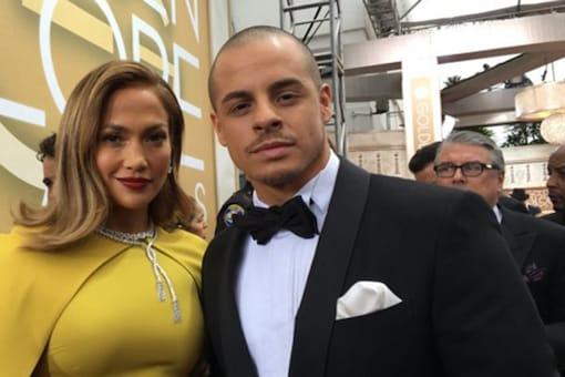 Jennifer Lopez looks stunning donning a yellow gown by Giambattista Valli.