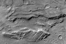 NASA reveals frozen ocean on Pluto's hulk-like moon Charon