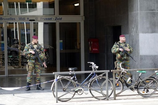 Belgian soldiers stand outside a closed entrance for the Midi railway station during high level security alert following the attacks in Brussels, Belgium. (Reuters)