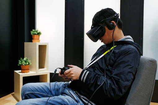 In this Jan. 6, 2016, file photo, Yining Hou uses the Oculus Rift VR headset at the Oculus booth at CES International, in Las Vegas.  AP Photo/John Locher, File