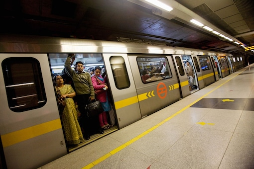File photo of commuters traveling in the Delhi Metro.