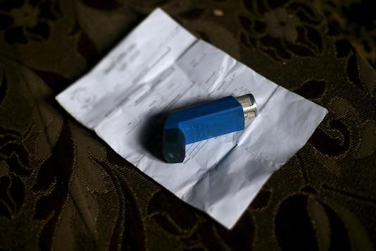 A bronchodilator placed atop of a prescription. (File Photo/Reuters)