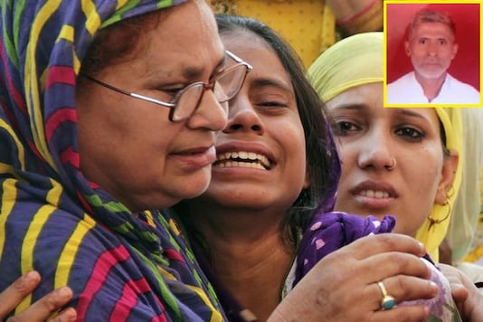 Relatives of Mohammad Akhlaq (inset) mourn after he was killed by a mob in September 2015, at his residence in Dadri, in UP/File Photo.
