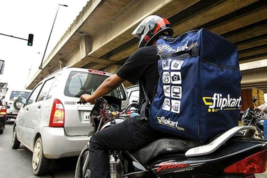 File photo of a man carrying products in a Flipkart bag.