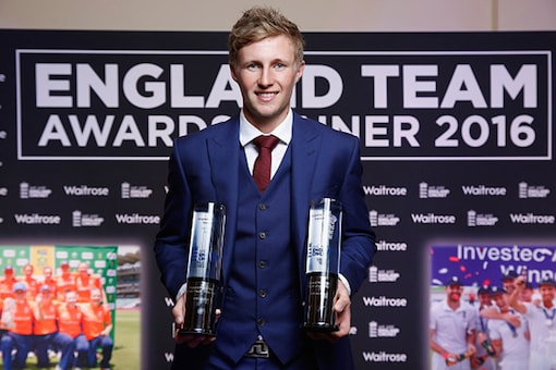 Joe Root poses with the England Test Cricketer of the Year and Limited Overs Cricketer of the Year awards during the England Cricketer of the Year Award dinner on May 16, 2016 in Leeds, England. (Getty)
