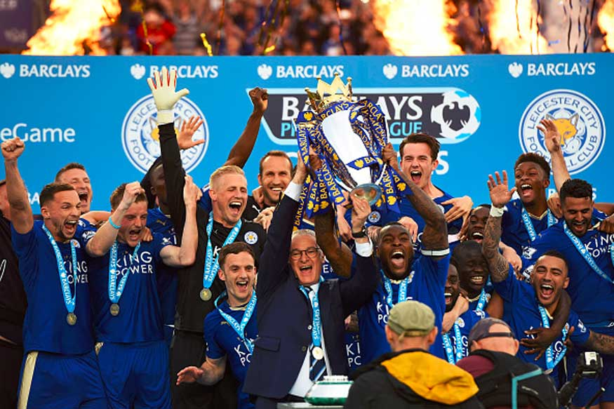 Leicester City players pose with the Premier league trophy after winning the league. (Photo Credit: Getty Images)