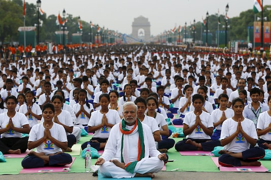 Prime Minister Narendra Modi performs yoga with others to mark the International Day of Yoga. (File Photo/Reuters)