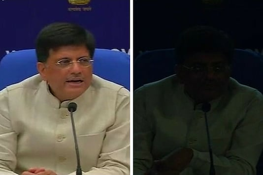 Before (L) and After (R): Power Minister's press conference where the power cut took place