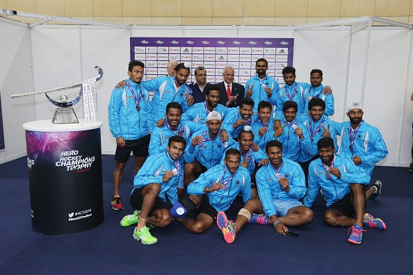 Indian team posing with its Champions Trophy silver medal. (Getty Images)