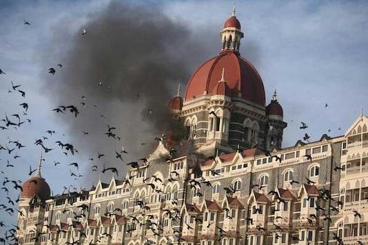 File photo. Smoke billows out from burning Taj Mahal hotel during 26/11 attacks in Mumbai. (File photo/ Reuters)