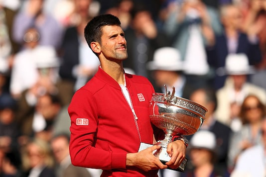 Novak Djokovic celebrates the trophy after winning his maiden French Open title. (Photo Credit: Getty Images)