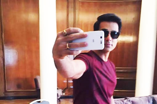 Actor Sonu Sood poses for a selfie with News18.com