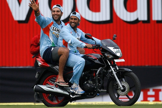 Yuvraj Singh and Mahendra Singh Dhoni ride a bike after the second one-day international cricket match against England in Indore on November 17, 2008. (Photo: Reuters)