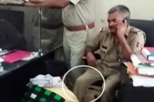 A video grab of SHO Ram Yagya Yadav who was suspended after he forced a man to get his feet massaged.
